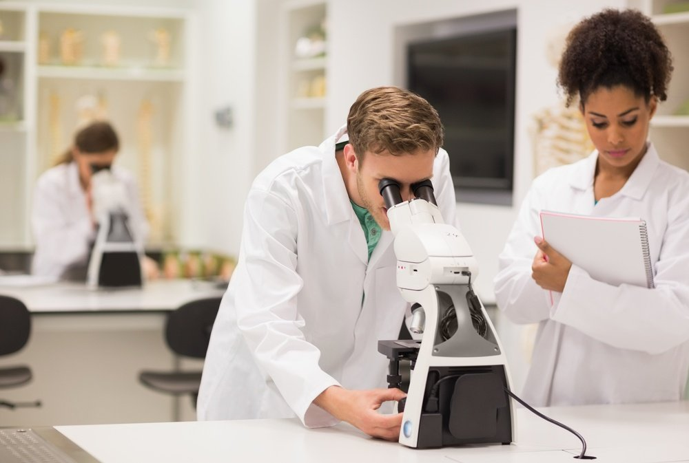 Medical-students-working-with-microscope-at-the-university