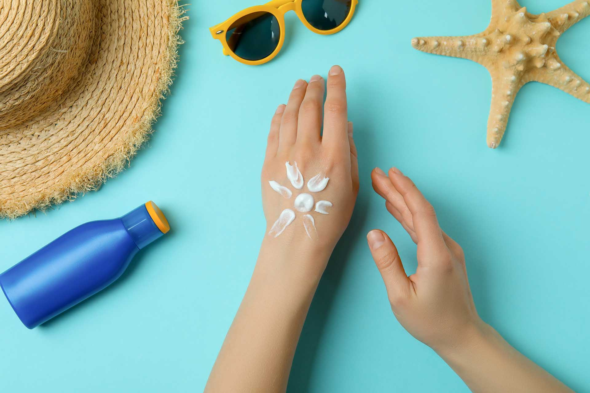 sunscreen on a persons hand